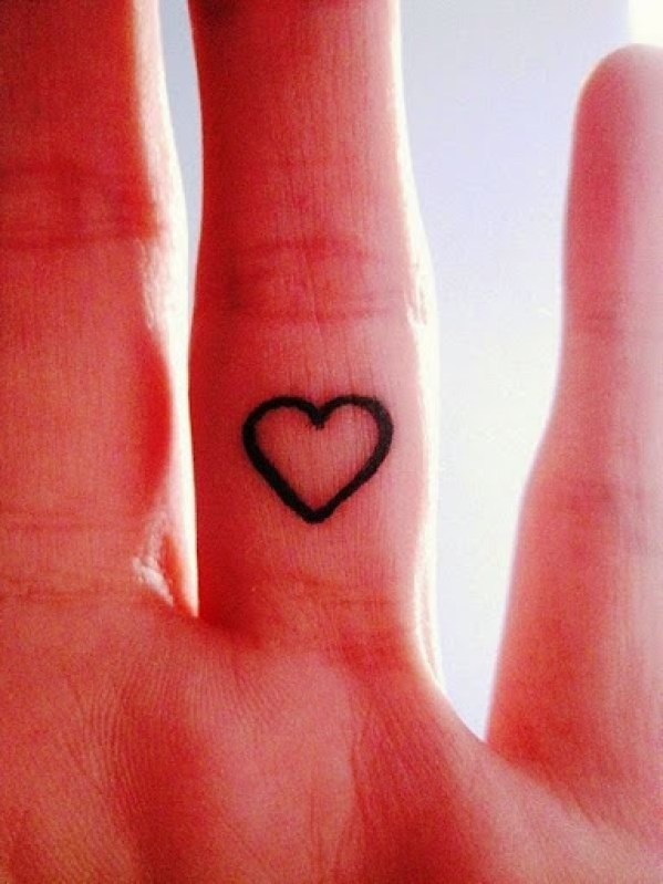 small heart outline tattoo on finger