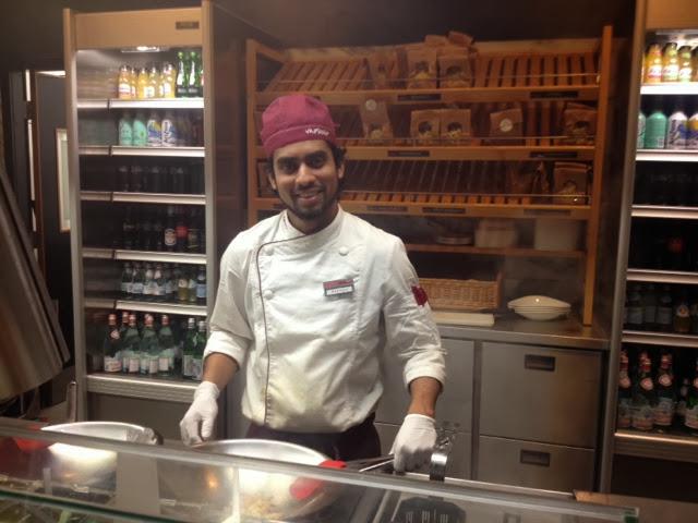A chef ready to cookto order at Vapiano