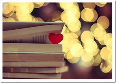 livro com coração no meio efeito de luzes