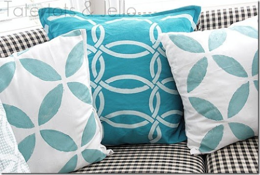 three stenciled napkin pillows