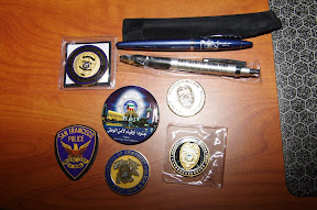Coins, pens, and pins.  Cops like shiny things.