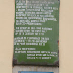 A sign on one of the buildings.