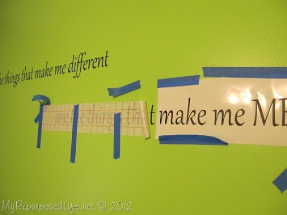 Applying Vinyl Saying on Wall (2)