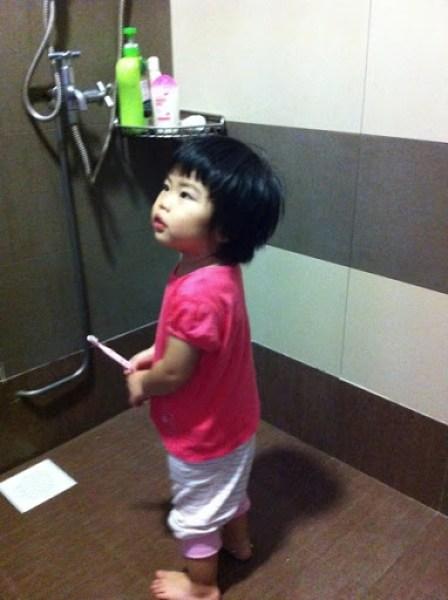 Yining Brushing Her Teeth