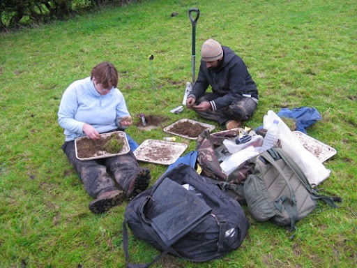 Natural History Museum Soil Biodiversity Group volunteers Irfaan and Victoria sorting soil for earthworms in Somerset