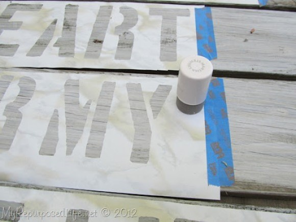 stenciling-a-sign-reclaimed-fence