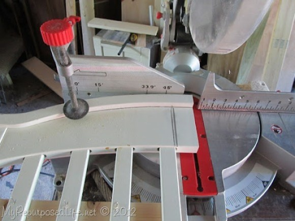 using a compound miter saw to cut a crib