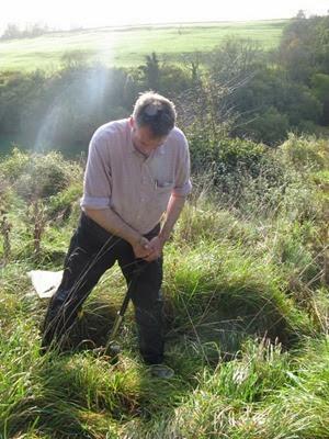 Dr David Jones digging an earthworm pit in Somerset