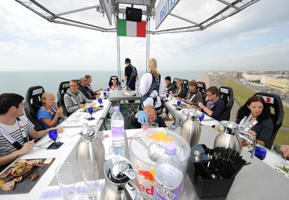 BRIGHTON – AUGUST 22 ; British Airways' competition winners pose for pictures /  dine in the sky in a 100ft high pop up restaurant during the #BABeachside event at Hove Lawns on August 22, 2013 in Brighton, England.  ( Photo by Stuart Wilson – Getty Images for British Airways)