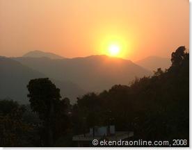 above the horizon, sun starts setting at early dusk
