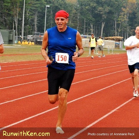 "Ken Skier (""the running photographer"") running barefoot at the 2010 EHS Kick'n Into Gear 5K in Exeter, NH"