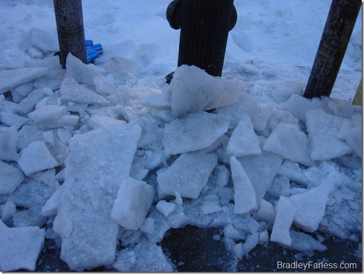 Chunks of ice that were scraped from the sidewalk.