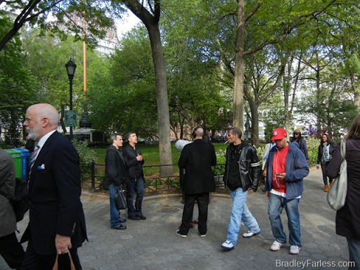 Two men being interviewed on camera in Union Square.