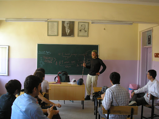 Me answering questions in an English lesson. The children from this school later threw their pennies together to give me 6 Lira.