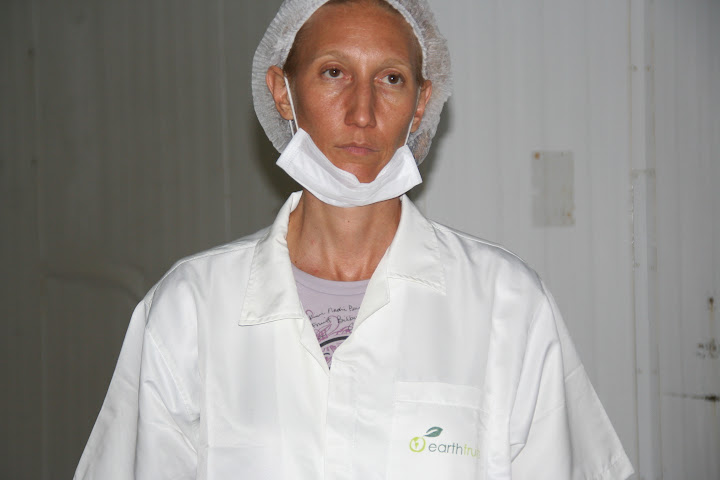 MonaVie Black Diamond Onyx Coale wearing an EarthFruits lab coat in Brazil