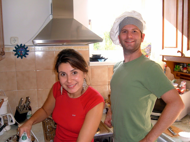 Dutiful Wife and Buddy Working Away in the Kitchen