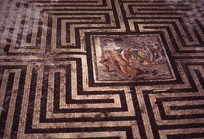 In Pompeii in the House of Faun is the House of the labyrinth where a famous mosaic tile of roman labyrinth design resides. At its center is Theseus and the Minotaur