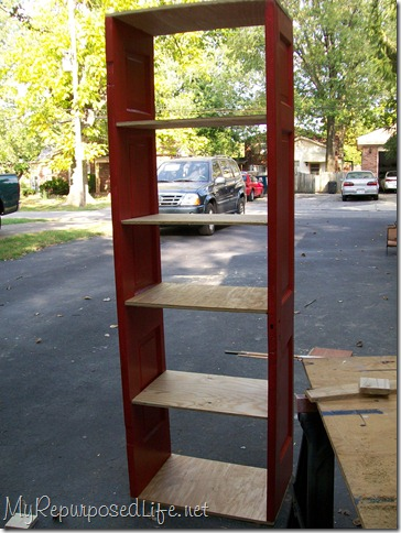 make a book shelf out of an old door