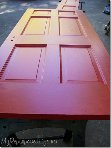 vintage door painted red to make a toddler bed
