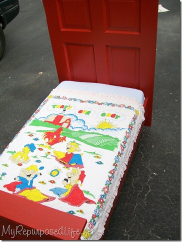 repurposed door into toddler bed