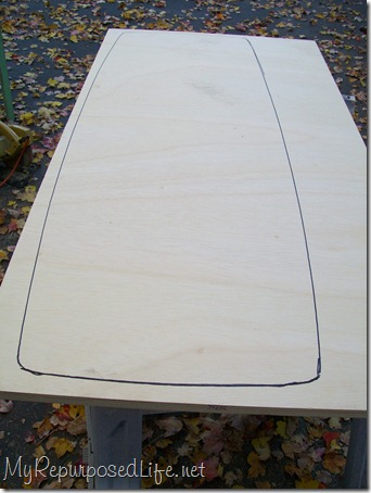 use old coffee table top to trace a new pattern