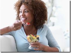 black-woman-eating-fruit-475x350