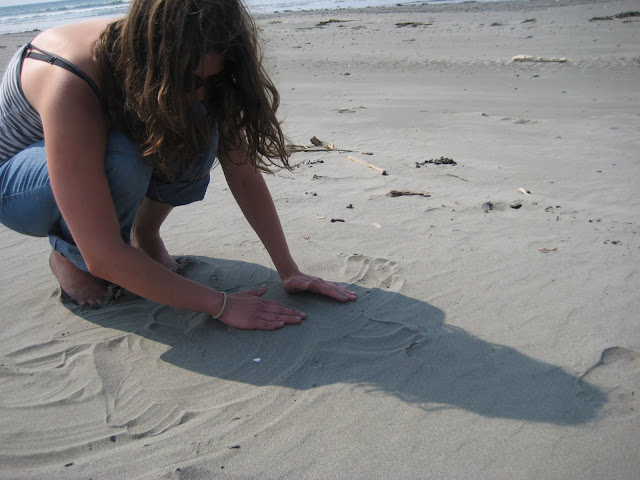 Playing in the sand, in case you couldnt tell.  We were making mazes for miniature sand crabs.