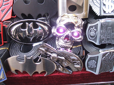 A Knife buckle and a skull with multi-coloured flashing eyes.