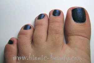 Bionic Beauty's navy blue sequined pedicure