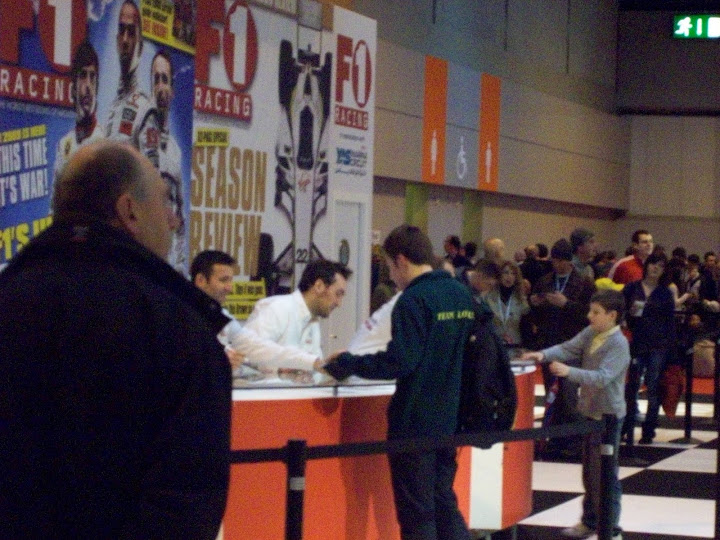Scott gets autographs from Minassian, Montagny and Wurz