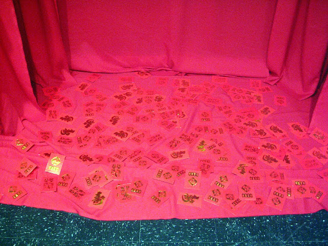 Scattering of Chinese New year money envelopes on the ground