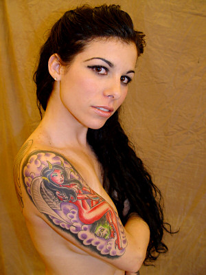Woman Tattoos at Pretty Woman Arm