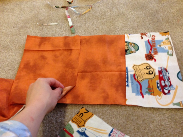 Coordinating fabrics cut for a toy car carrier.