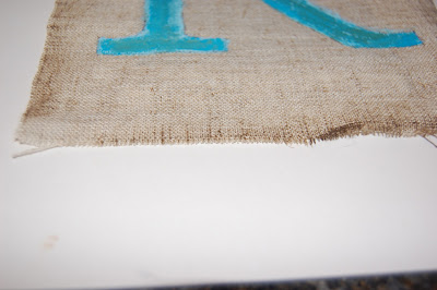 distressed monogram on burlap