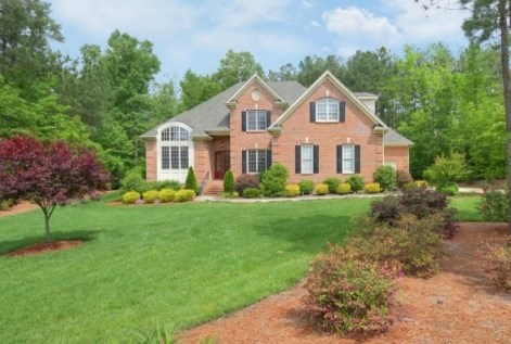 Mature landscaping with a resale home