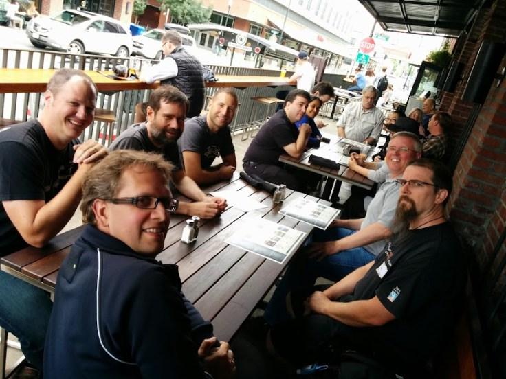 FLOSS Community Metrcis meeting attendees taking some beers in a bar