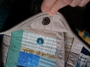 Pocket held open to see magnetic closure