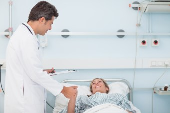 Photo Of Doctor And Patient Discussing Plastic Surgery Recovery