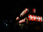 Red paper lanterns outside a shrine