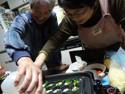 My host parents making takoyaki
