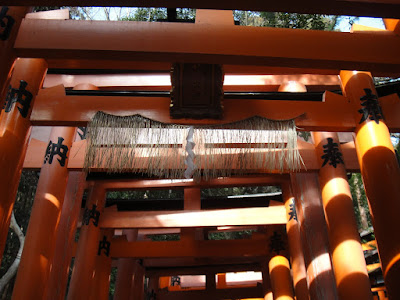 Torii with wheat suspended across them