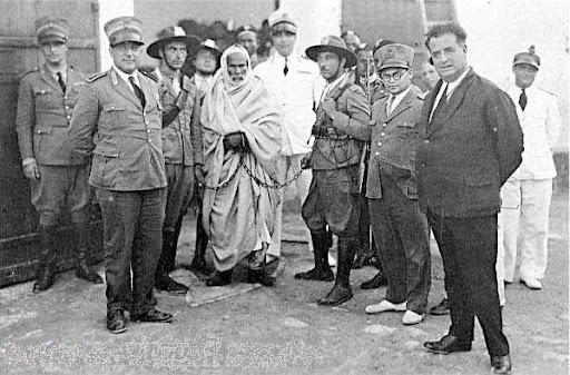 https://i2.wp.com/lh5.googleusercontent.com/_hFyIVHLPW40/TaYfL-07hRI/AAAAAAAAG54/T6ceYNvpvKo/Omar_Mokhtar_arrested_by_Italian_Fascists.jpg?w=584&ssl=1