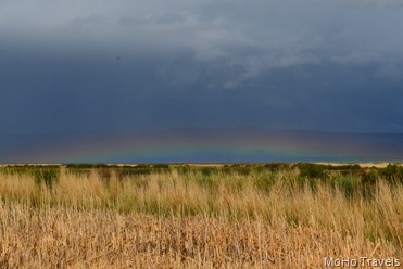 low hanging rainbow over Summer Lake Refuge