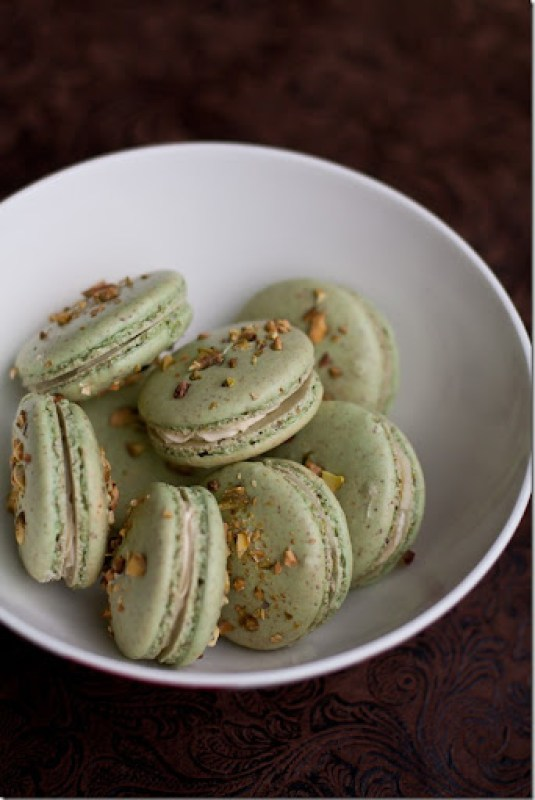 Pistachio Macarons - Fragile AlmondMeringue cookie flavored with Pistachios and sandwiched with pistachio french buttercream.