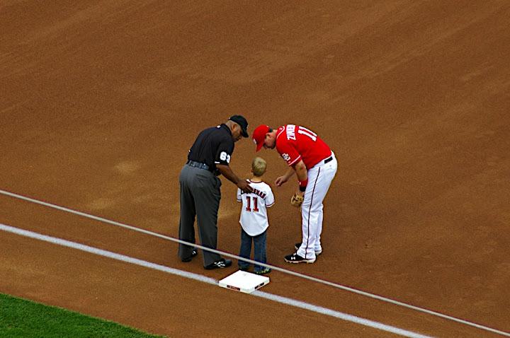 Zimmerman and Umpire talk to starting 9 kid