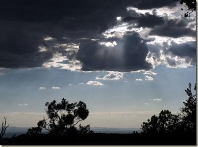 Sun through clouds over Crazy Jug Point Kaibab National Forest Arizona