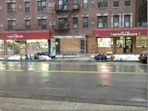Trash piling up on 14th street after the December 26th blizzard in New York City.