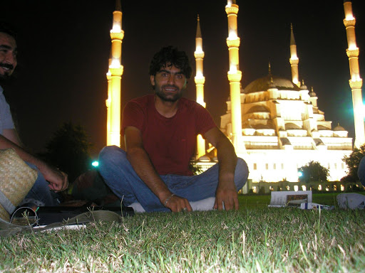 Ergun sitting in front of the Sapanca Mosque. Hed been waiting since 3.