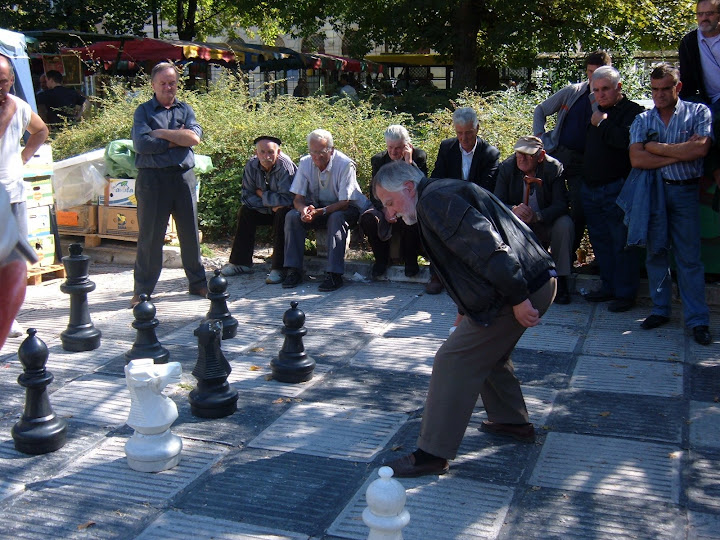 Men Playing Chess in the Center Square by the Bee Festival