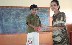 Teacher giving prize to anbarasan